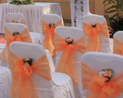 Banquet chairs orange ribbon