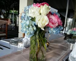 Blue Hydrangea and white rose centerpiece